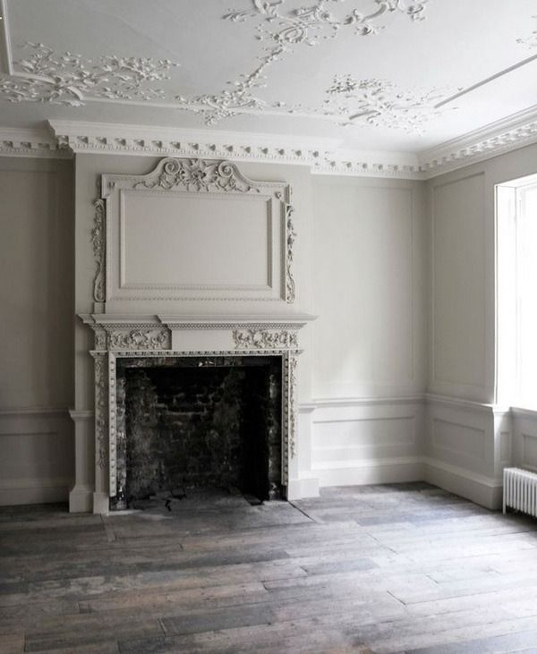 Stunning rococo ceiling with a rustic fireplace