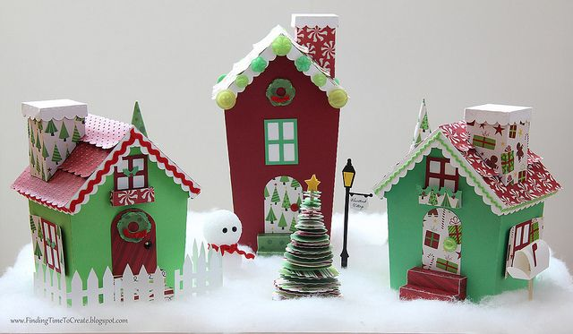 "Make the village out of popsicle sticks and then decorate it with paper.  It would be cute to place your elf in once your child has ""found"" him in the morning."