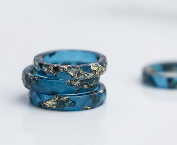 This thin faceted sapphire blue stacking ring is made from high quality eco resin. The ring contains sparkled imitation yellow gold flakes. This resin ring is perfect for stacking.  My resin jewellery is cast in handmade by me silicone molds, hand sanded and hand polished. Minor imperfections may result such as tiny bubbles. Each ring is unique and slightly different, please keep in mind that yours wont be identical to the photo but very similar.    Available sizes (US): 4, 4 1/2, 5 1/2, 6…