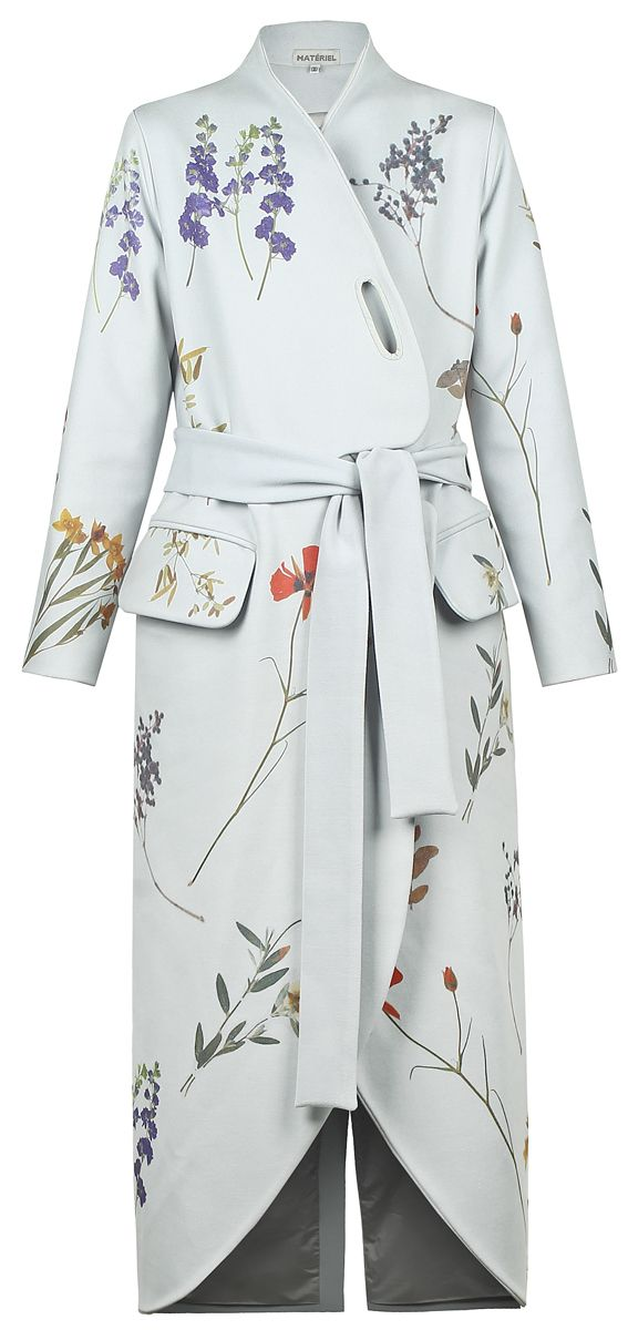 Sky blue long coat with side pockets, matching belt, round cut-outs at the front and printed flower details. 100% polyester Dry clean only Made in Georgia