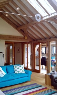 Splashes of colour in oak frame barn house