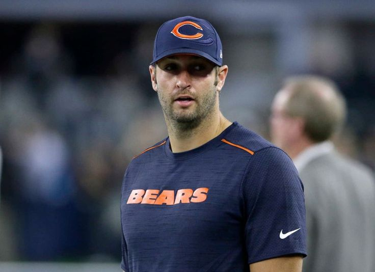 Chicago Bears quarterback Jay Cutler stands on the field watching the team warm up before an NFL football game against the Dallas Cowboys on Sunday, Sept. 25, 2016, in Arlington, Texas.