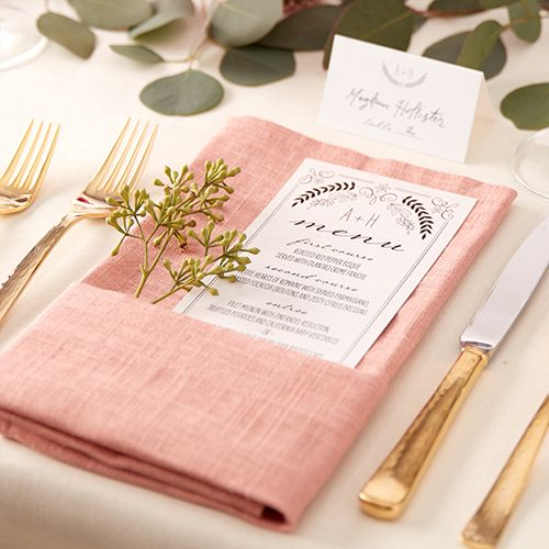 For the outdoor garden wedding reception, add a rustic menu card to inform your guests what you'll be serving that night.