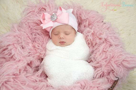 Her First Bow™ by Infanteenie Beenie™ ~ the original, award winning newborn hospital hat for your baby girl.  Guaranteed to fit & stay snug on all newborns.   Offering boy and girl designs.   Please visit, www.infanteeniebeenie.com