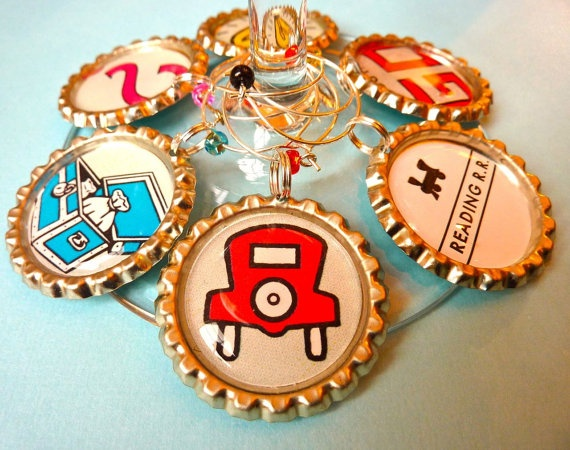 Monopoly wine charms! This site is selling these for 16 dollars, but you can easily make them yourself out of bottle caps and $3 epoxy from Lowe's.