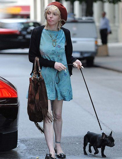 Uncle Fester out for a stroll with Courtney Love