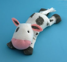 """Cow craft - made from socks. Goes with the book """"Moonstruck - the true story of the cow who jumped over the moon"""""""