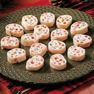 Christmas Party Pinwheels  2 packages (8 ounces each) cream cheese, softened  1 package (.4 ounces) ranch salad dressing mix  1/2 cup minced sweet red pepper  1/2 cup minced green pepper  1/2 cup minced celery  1/4 cup sliced green onions  3 to 4 flour tortillas (10 inches)