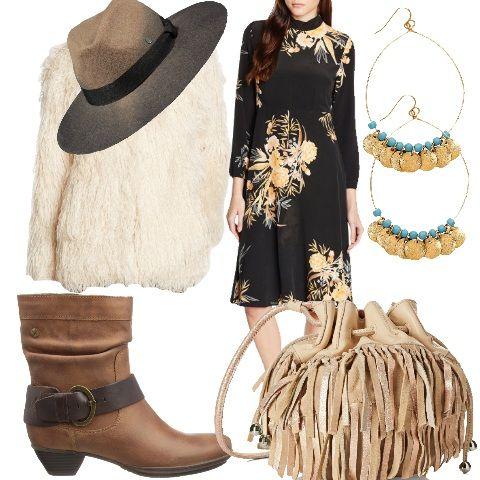L'eleganza si fonde con un'attitudine disinvolta che detta le tendenze di questa stagione. Tessuti morbidi e fluidi che ondeggiano con la silhouette a ogni passo, come per questo abito al ginocchio in nero a fantasia floreale, e pellicce ecologiche dal pelo lungo che allungano la figura. Gli accessori sono fondamentali per un mood folk; cappelli a larghe falde, qui abbinato in lana color marrone sfumato, e borse con frange in tono. Le scarpe abbinate sono stivaletti alti con fibbia alla…
