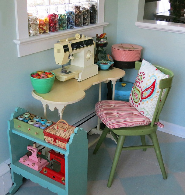Sweet little sewing nook! Love the table& the toy sewing machines & the threads in a bowl....button on window sill