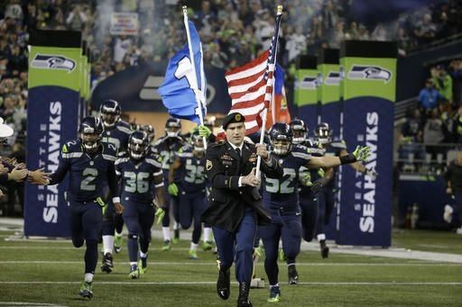 """Monday Night Football: Bills vs. Seahawks:   November 7, 2016  - 31-25, Seahawks  -     U.S. Army Special Forces Staff Sgt. Jonathan McLaughlin runs with a U.S. flag as he leads the Seattle Seahawks out of the tunnel in support of the NFL's """"Salute to Service"""" military appreciation program before an NFL football game against the Buffalo Bills, Monday, Nov. 7, 2016, in Seattle. (AP Photo/Elaine Thompson)"""