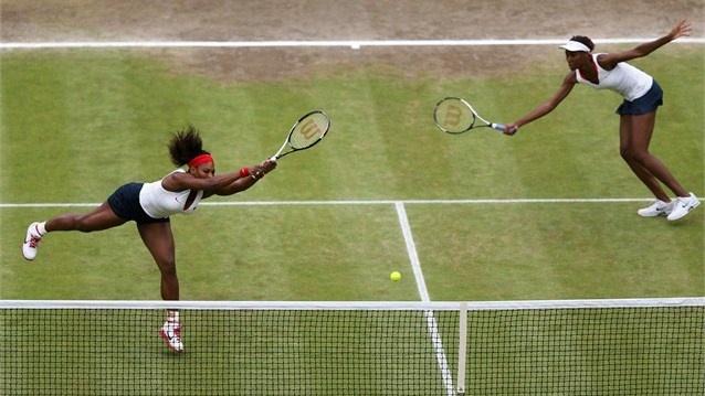 Serena Williams and Venus Williams of the USA return a shot