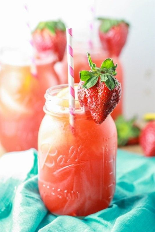 A delicious recipe for Strawberry Lemonade, with lemons, sugar, strawberries and water.