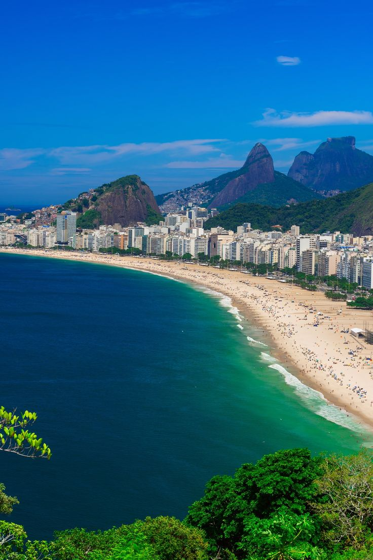 Copocabana Beach, or Praia de Copacabana, is the Rio de Janeiro of the tourist brochures and deservedly so. It's a breath-taking 2.5mi (4.5 km) stretch of bright sand that's filled with people luxuriating in the sun and soaking up the atmosphere.