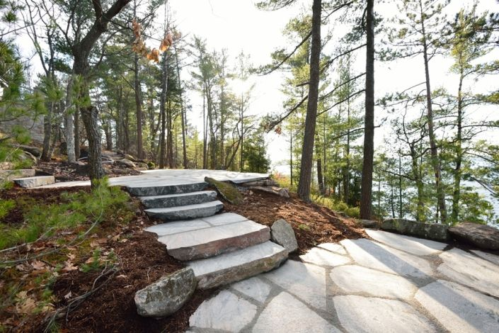 our vision for your outdoor living spaces is limited only by your imagination. Fully utilizing the sometimes confined spaces on a cottage property takes planning. The design for this project used a tiered patio system to effectively make the most of the rough terrain from the cottage to the lake.
