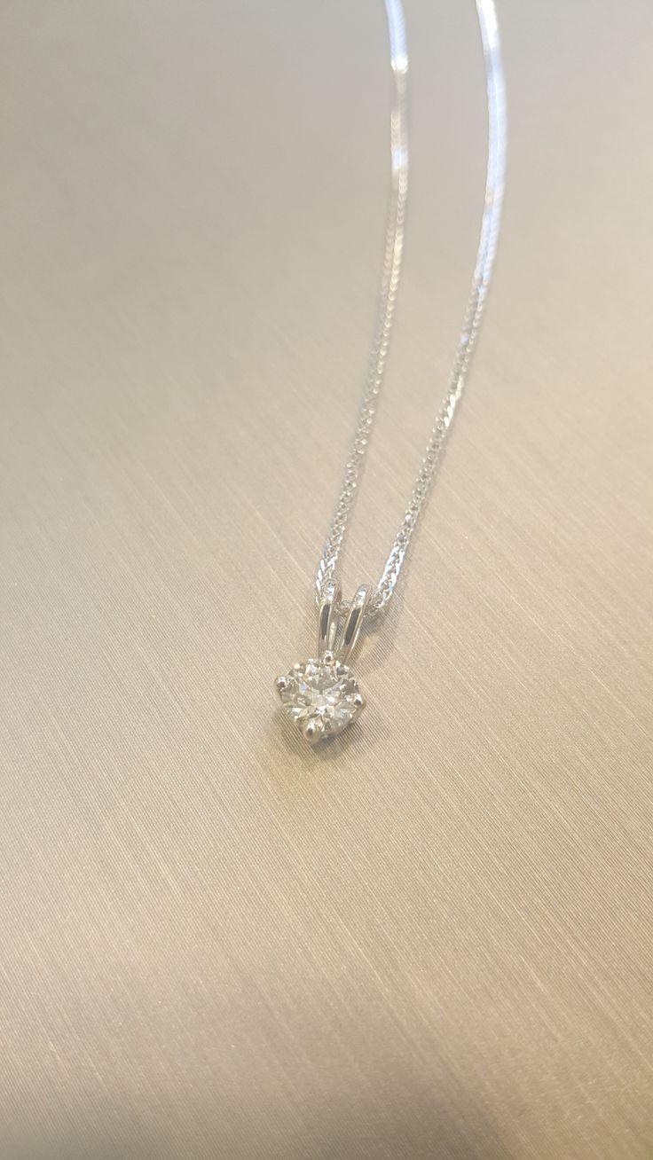 .50 ct diamond solitaire pendant set into white gold