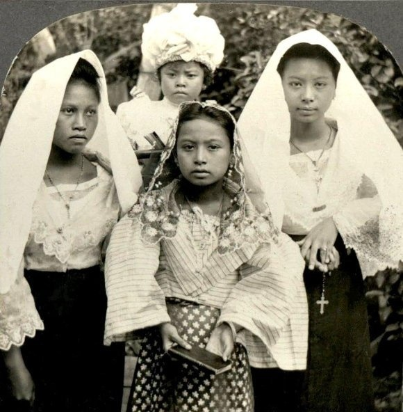 """Catholic Girls Of The Philippines"" Circa 1900s     I love this picture. First time to see this one. The only time for me to see a girl holding the Tagalog prayer book called ""Matuwid na Landas"" ( The Straight Path) by Joaquin Tuason (1842- 1908). It is a compedium of formula prayers from the time you wake up until you die. It is a very popular book prior to Vatican II in 1965 when the Catholic rites and liturgy were revised"