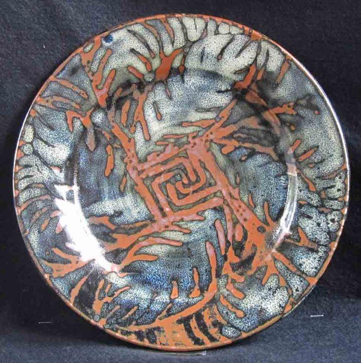 Wax resist jun over tenmoku dinner plate