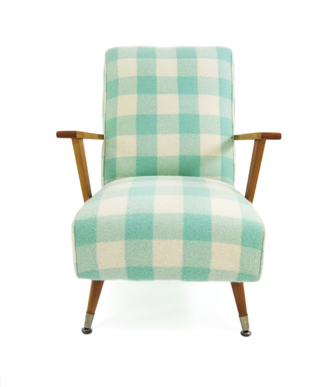 Vintage woolen blankets used as upholstered chair coverings, by NZ company Revival Furniture.