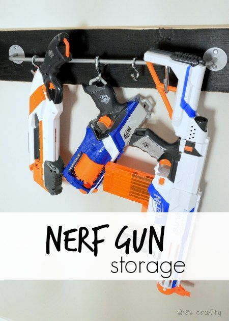 IKEA toy storage hacks for the bedroom. IKEA BYGIL rail for nerf gun storage via Shes crafty / www.grillo-designs.com