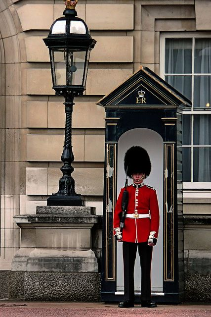 Guard at Buckingham Palace, London, UK. I want to see Buckingham Palace, and take a photo outside - I promise not to bother or irritate the guards! They have an important, ceremonial, job.