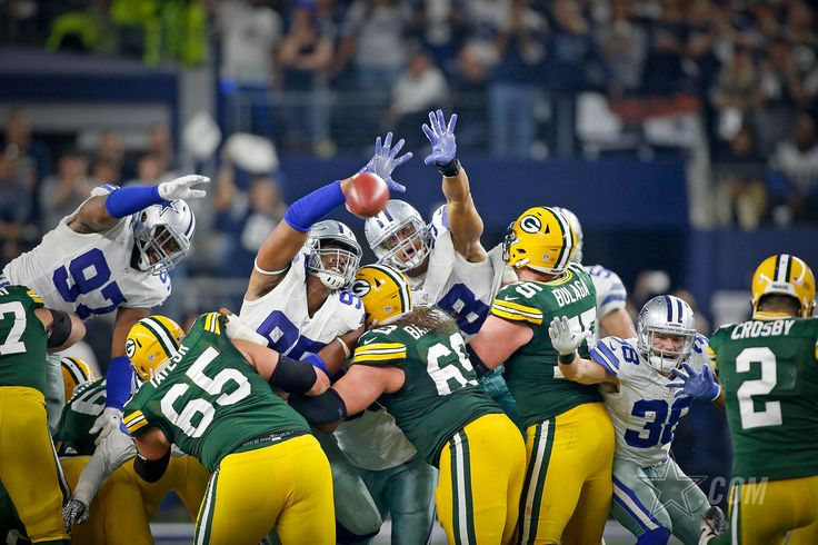 View some of our favorite photos, updated throughout the Packers vs Cowboys game.
