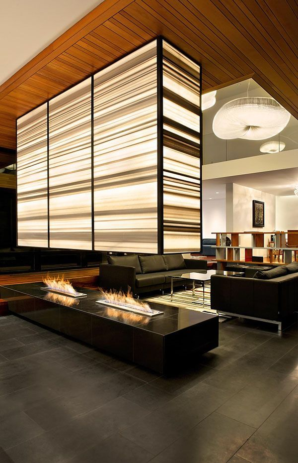 Love the lit room divider/ fireplace ventilation Stunning modern family home in Ontario: Thorncrest House