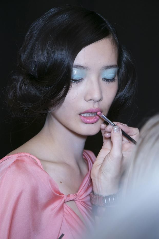Li Wei backstage at Badgley Mischka Spring/Summer 2014