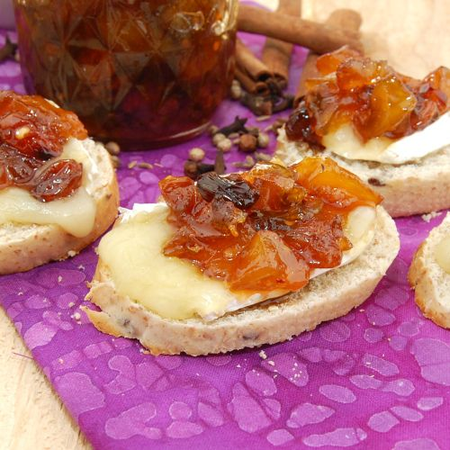 Mango Chutney with Brie on French baguette slices.   I WANT THIS NOW!!!
