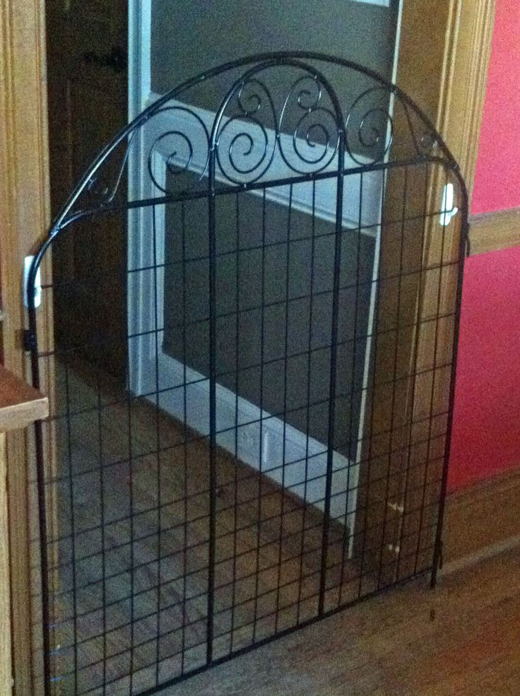 Lightweight decorative fencing panel used as small pet gate
