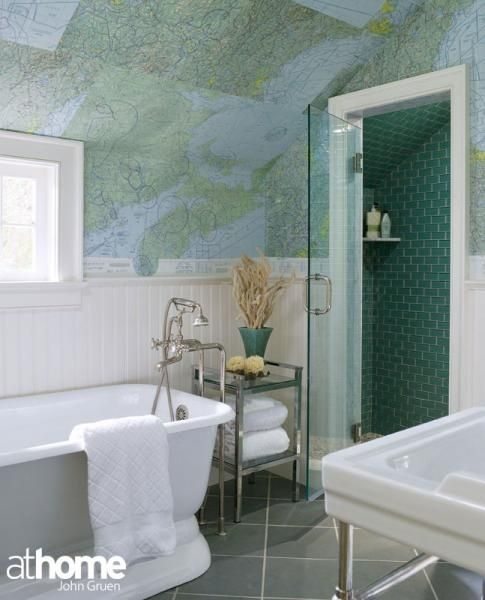 bathroom ceiling covered in maps, so neat. I'd put a mark on everywhere I've been :)