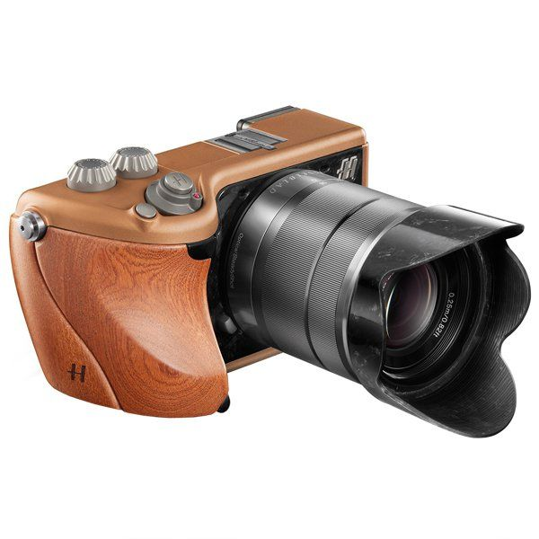 Every photographer with a sense of style will dream of this camera from Hasselblad. Its metal body is embellished with a series of woods or leathers. http://www.zocko.com/z/JEqtG