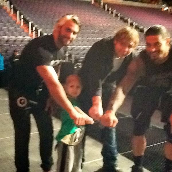 """Seth Rollins, Dean Ambrose, & Roman Reigns with Connor the Crusher"