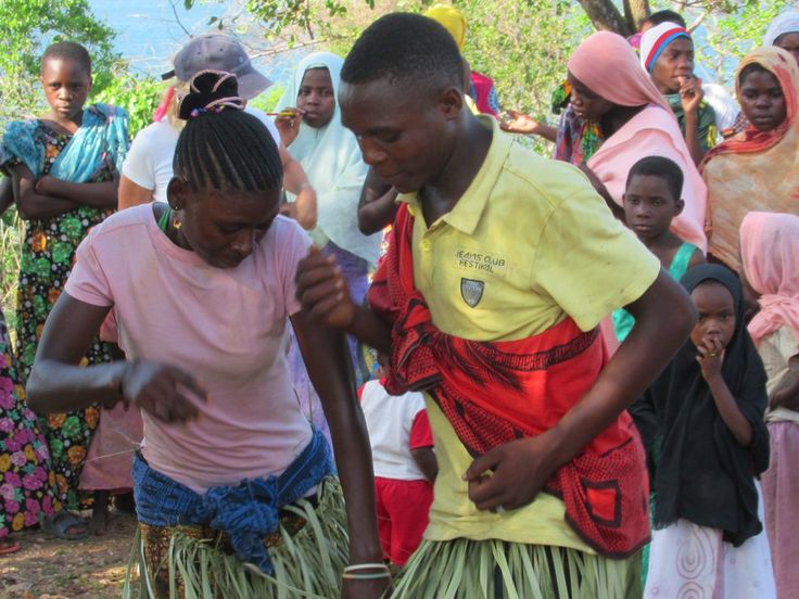 Residents of Kilwa Kisiwani Island, Tanzania, perform a dance for overseas visitors.