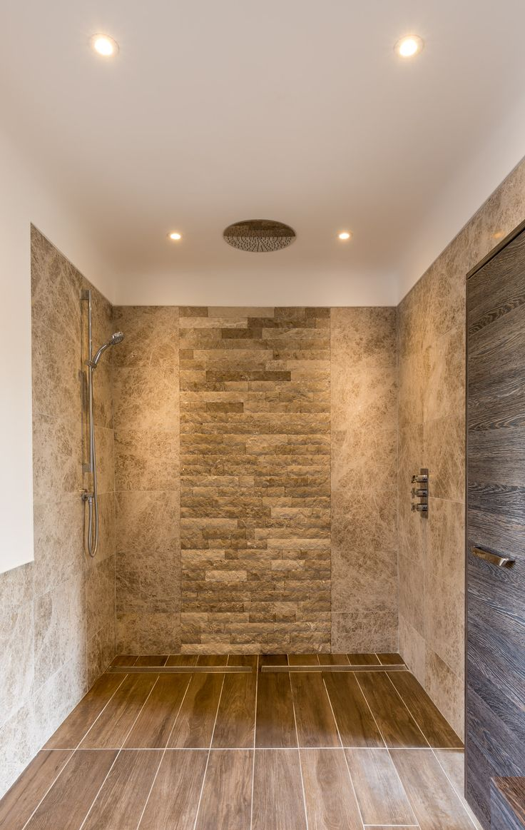 Large contemporary walk in shower with feature rustic