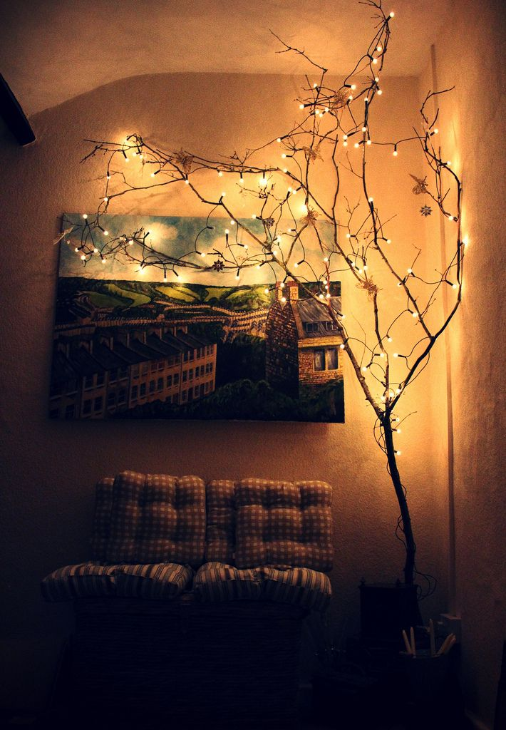I like the idea of an indoor fake tree with white lights for Indoor light decoration ideas