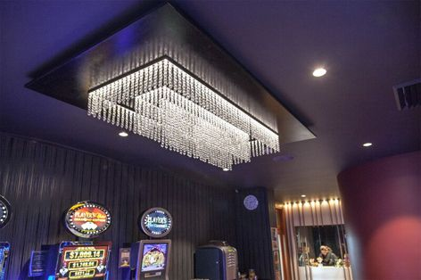 Interior design feature lights made for a tight budget in a gaming room. The lights are made of acrylic crystals in strands that are then attached to a paint finished aluminum frame. Di Emme completed all the lighting interfacing and installation #interiordesign #designer #architect #builder #lightingdesign #lights