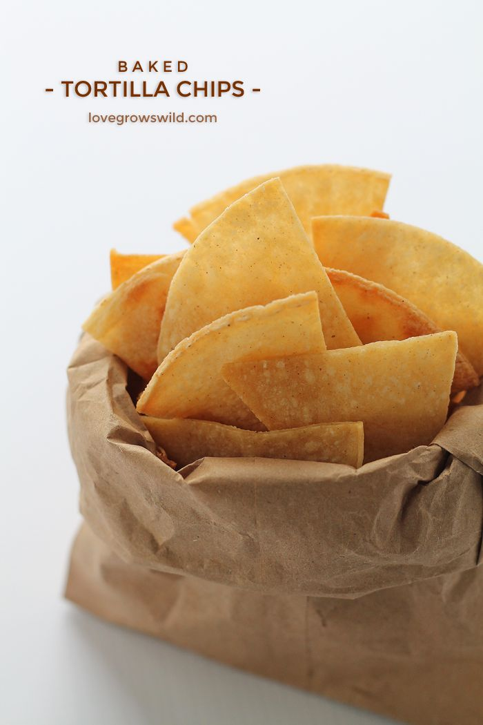 Easy, homemade Baked Tortilla Chips with only 3 ingredients! Perfect for dips, salsa, nachos, and more! | LoveGrowsWild.com