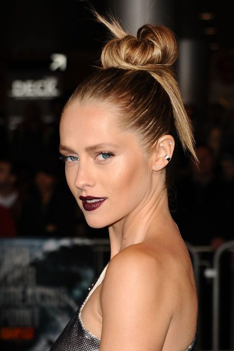 Create sculptural interest with a slick, stylised top knot this festive season.