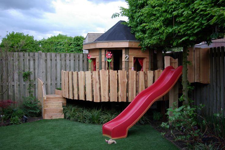 tuinontwerp-tuinaanleg-hovenier-eindhoven-helmond-nuenen-kindvriendelijke-tuin-glijbaan-speelhuisje-kunstgras