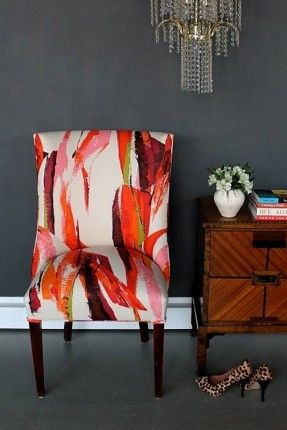 Grey painted walls! Love how the orange and pink abstract fabric-covered chair pops against it! And the wood of the banquette just looks that much richer, too.