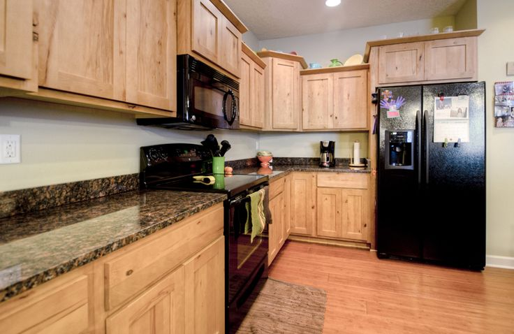 Custom kitchen with tan brown granite countertops with ge - Custom kitchen appliances ...