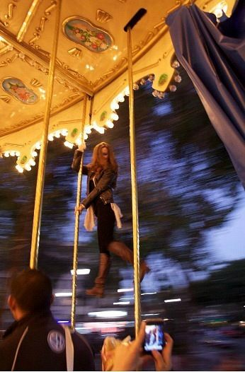 Jenyne Butterfly pole dancing on a carousel :) This would so be me