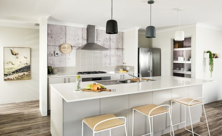 The galley kitchen offers a 1200mm Caesarstone island bench and walk-in pantry