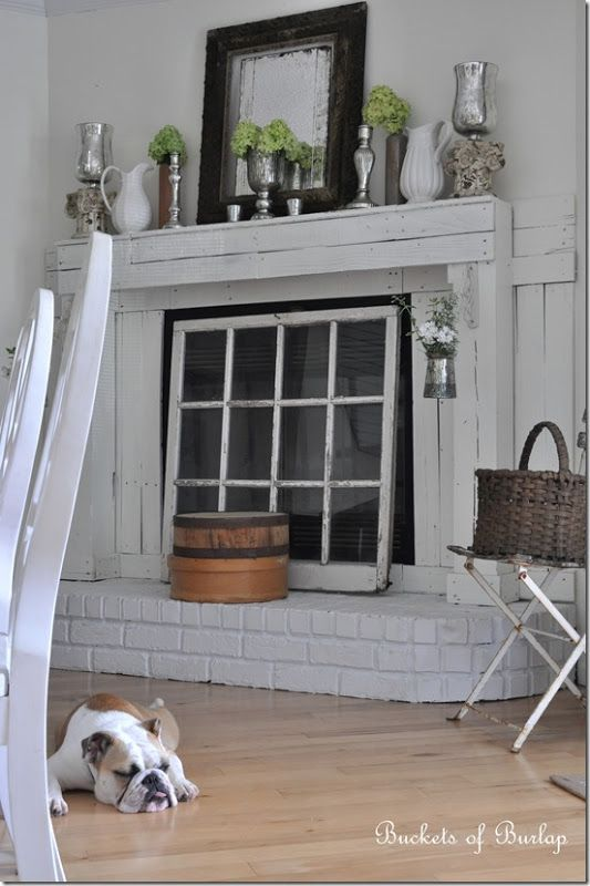 I don 39 t like the fireplace surround but the vintage window - Ideas to cover fireplace opening ...