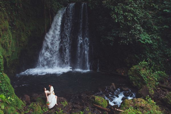 Jaw dropping waterfall in Costa Rica as the backdrop for this sexy wedding photo! Photos by Costa Vida Photography