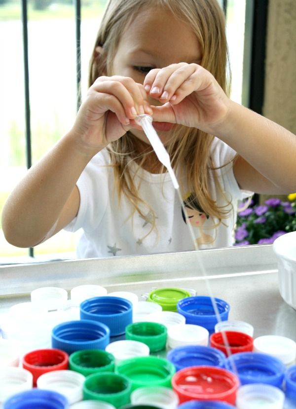 Reduce, reuse, recycle study- Place a variety of caps, dish of water, and eye droppers onto a tray......great way to reuse the caps and work of fine motor strength as well!