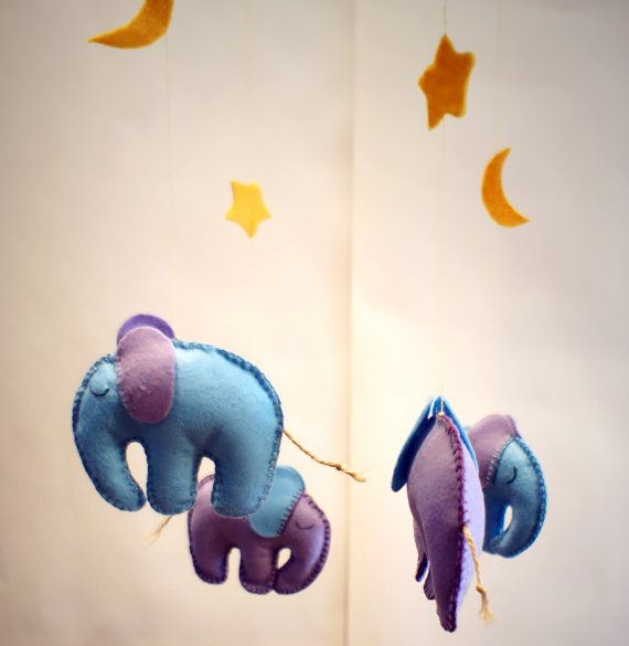 Check out this item in my Etsy shop https://www.etsy.com/listing/197241060/felt-mobile-elephants-star-moon-baby