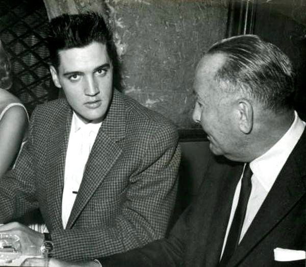 Elvis at a Bad Nauheim restaurant ( Germany ) in august 1959 with movie Producer Hal Wallis.