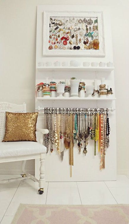 Use Various dishes for bracelets, a curtain rod with hooks for necklaces, shallow vases/containers for rings, and then a frame with mesh for earrings... would keep things EASILY accessible and able to see everything at once!